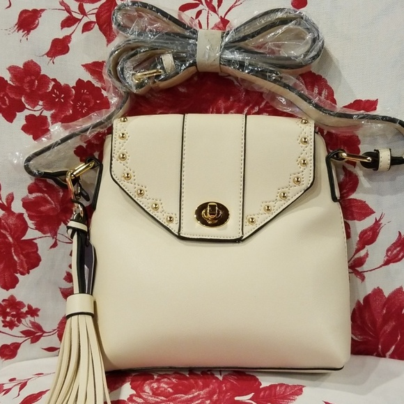 2966acf7db67 Ivory crossbody purse. NWT. blue heaven